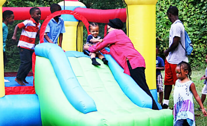 Kids play on an inflatable bouncey house at the 2nd Annual Banu Adam family reunion on Eid 2015