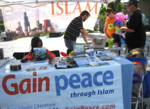 GainPeace volunteers man a Dawah table filled with information about Islam.