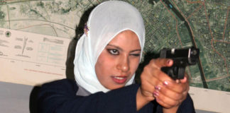 A Muslim woman takes sturdy aim of a handgun indoors. Take advantage of any self-defense classes for women offered in your area. Usually men are not allowed to be present during the classes, so inshaa'Allah you will feel comfortable & able to focus on your instructor & getting the techniques correct.