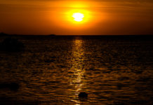 A bright sunset glimmers over the Red Sea.