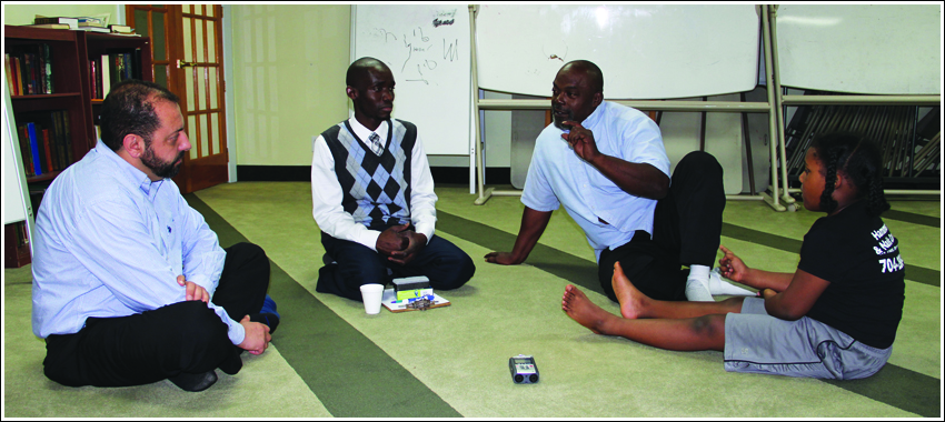 Arthur sits with some of the community to discuss Islam and how to practice his new faith.