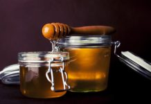 Honey in jars with a honey dipper. Delicious.