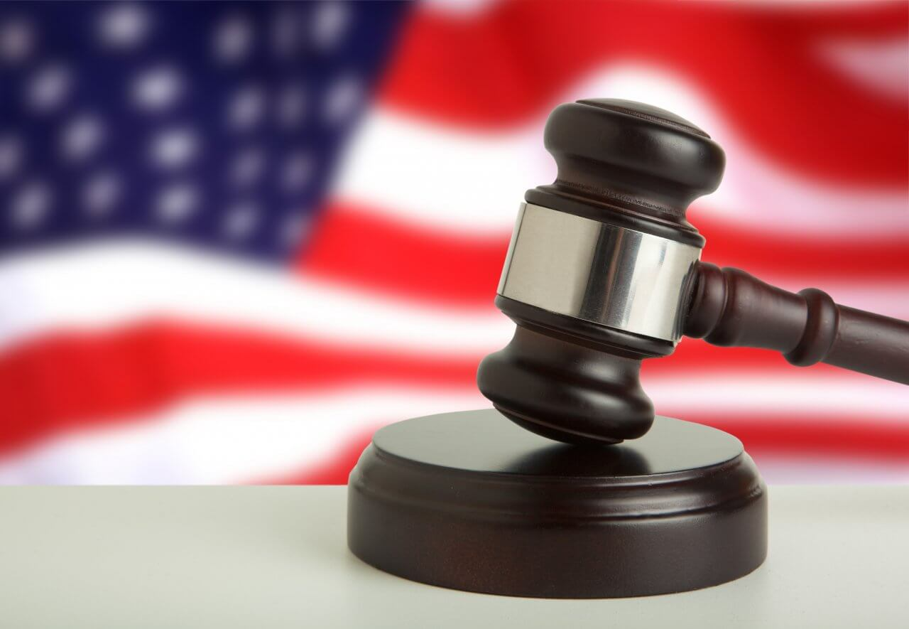 Religious liberty upheld. Concept photo shows a judge's gavel in front of a blurred American flag.