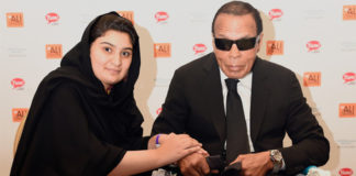 Hadiqa Bashir sits with Muhammad Ali at the 3rd annual Muhammad Ali Humanitarian Awards.