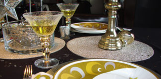 Silver & Gold look is accented by Eid Creations Crescent and star ensemble plates and napkins. Plastic goblets and chromed plastic forks and spoons set things off beautifully at an affordable price.